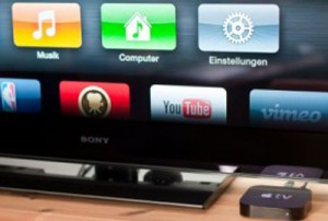 Apple TV in front of an LCD TV