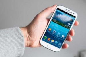 Galaxy smartphone in hand.