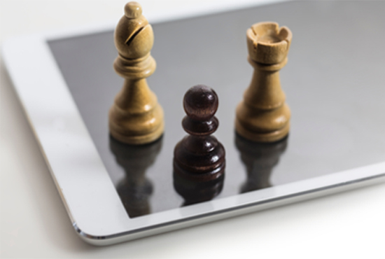 mobile app strategy depicted by tablet with chess pieces