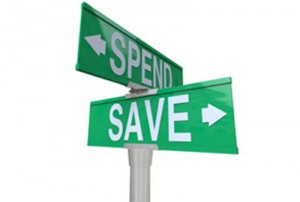 Sign post pointing to spend and save.